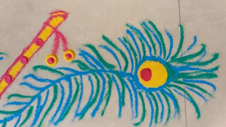 border rangoli peacock feather Kolam